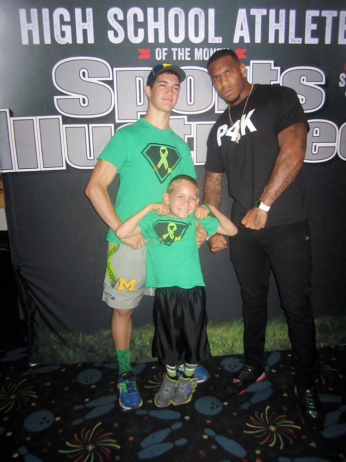 Hunter, Braden and the NFL's Eric Ebron flex for the camera.