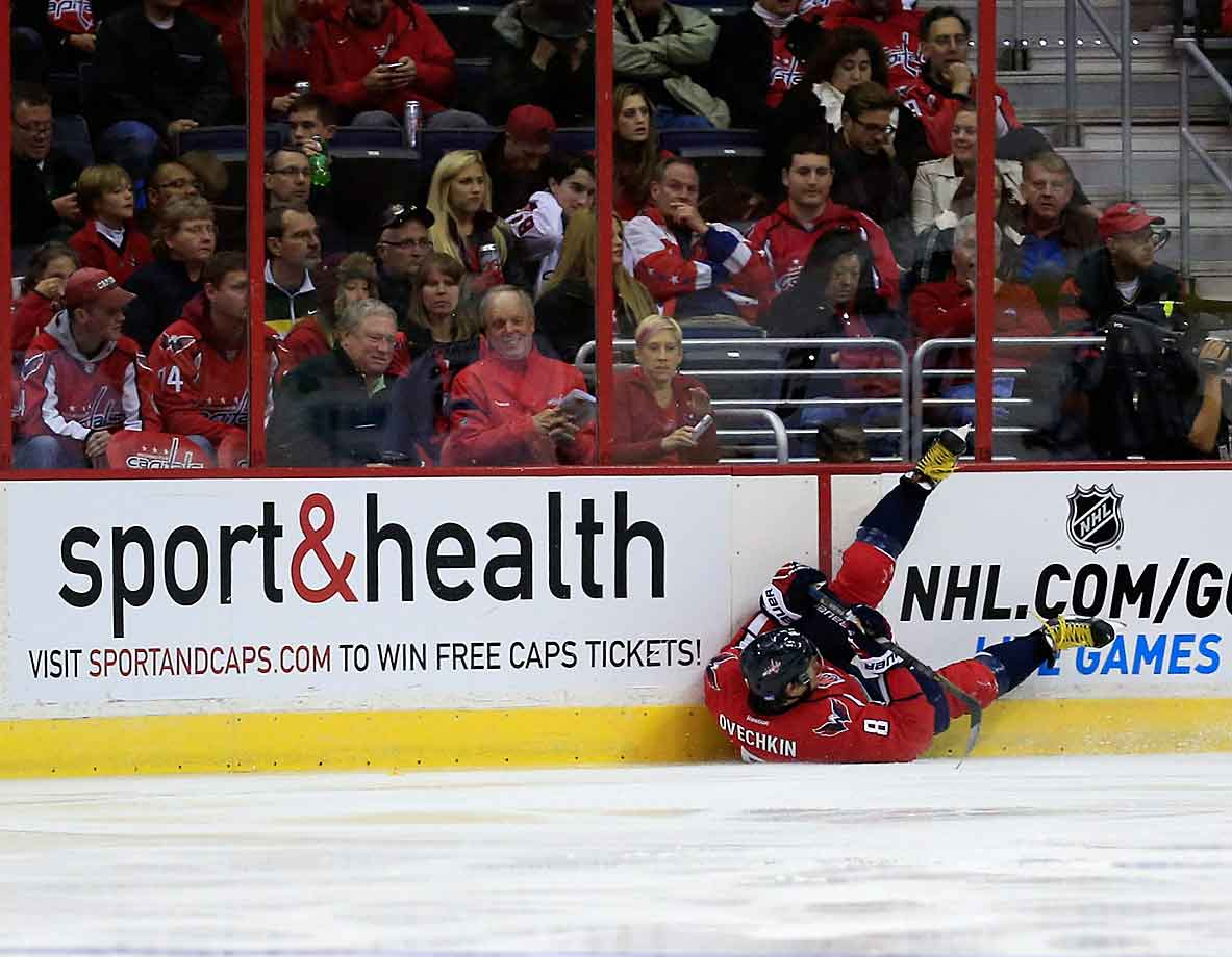 Tumbling stock: Struggling Capitals sniper Alex Ovechkin was unceremoniously sent into the boards by the Coyotes during the third period of a Nov. 2 game at Washington's Verizon Center.
