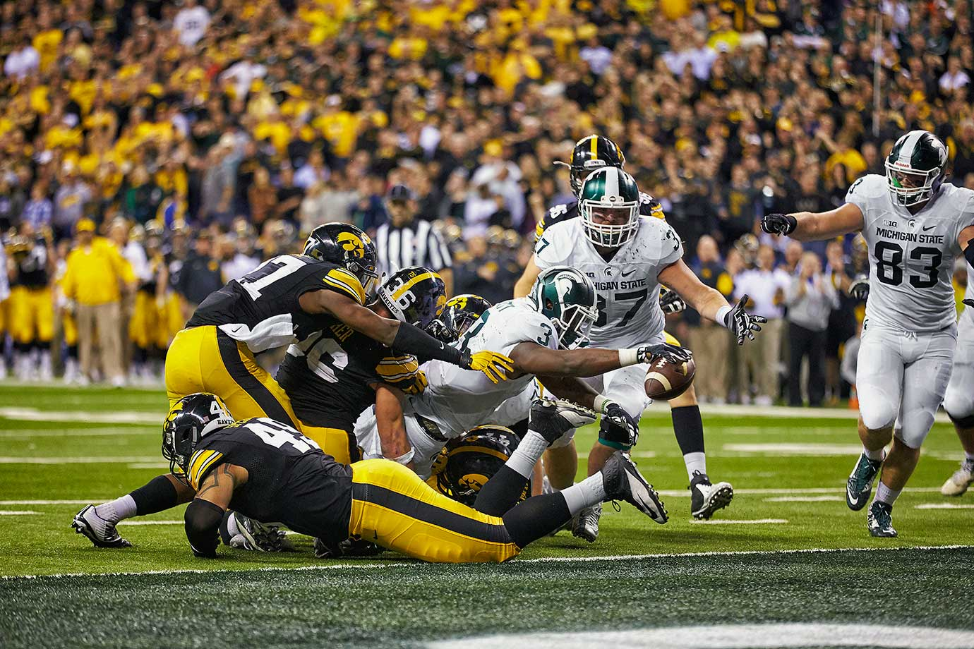In this de facto College Football Playoff quarterfinal slugfest, Michigan State capped off its second Big Ten title in three years using a 22-play, 82-yard drive that drained nine minutes off the clock before L.J. Scott spun and reached into the end zone from a yard out with 27 seconds left.