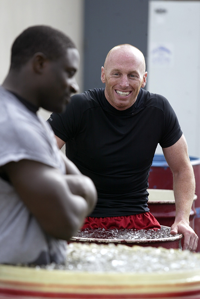 Former quarterback Jeff Garcia and running back Garrison Hearst, then of the San Francisco 49ers, sit in tubs of ice during 49ers training camp in July 2003.