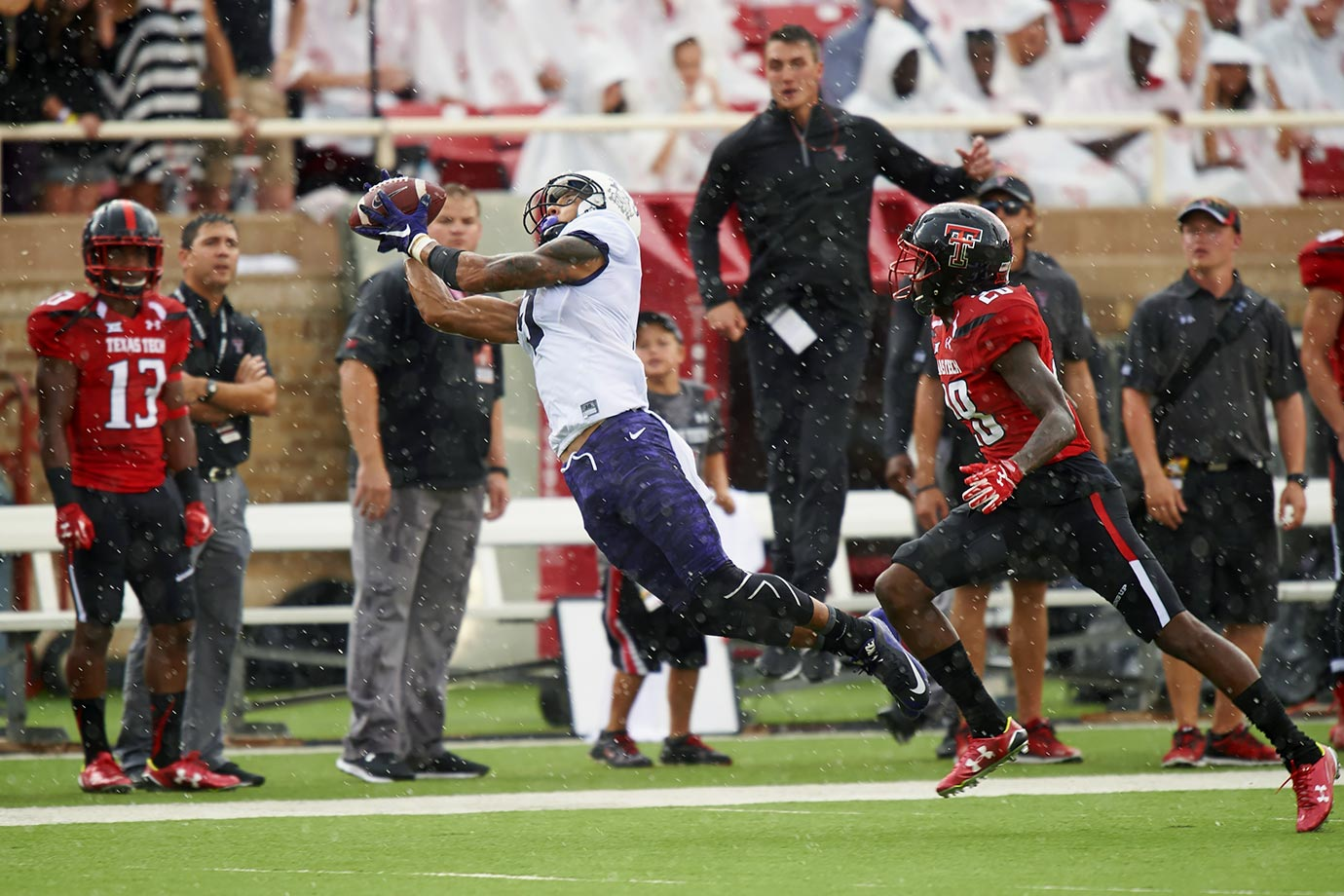 "The Horned Frogs' star runs 6'4"" and uses all of that frame to ward off defenders when the ball is in the air. His 1,300 yards and 14 TDs this season were the product of a great offensive system, sure, but he earned those stats by creating space."