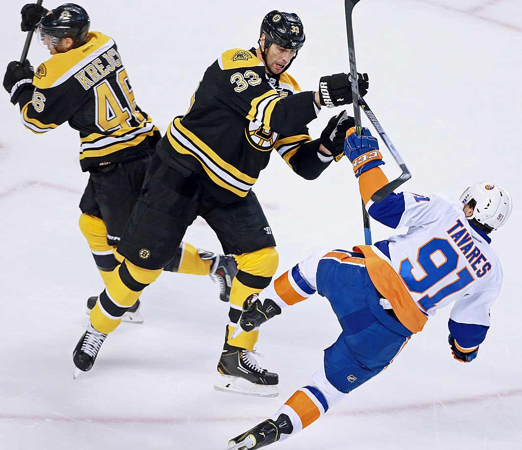 This knee-on-knee collision at Boston's TD Garden ended up hurting the bigger man the most. The Bruins' towering captain injured his knee, was sent to the hospital and was told he'd be out of action for four-to-six weeks.