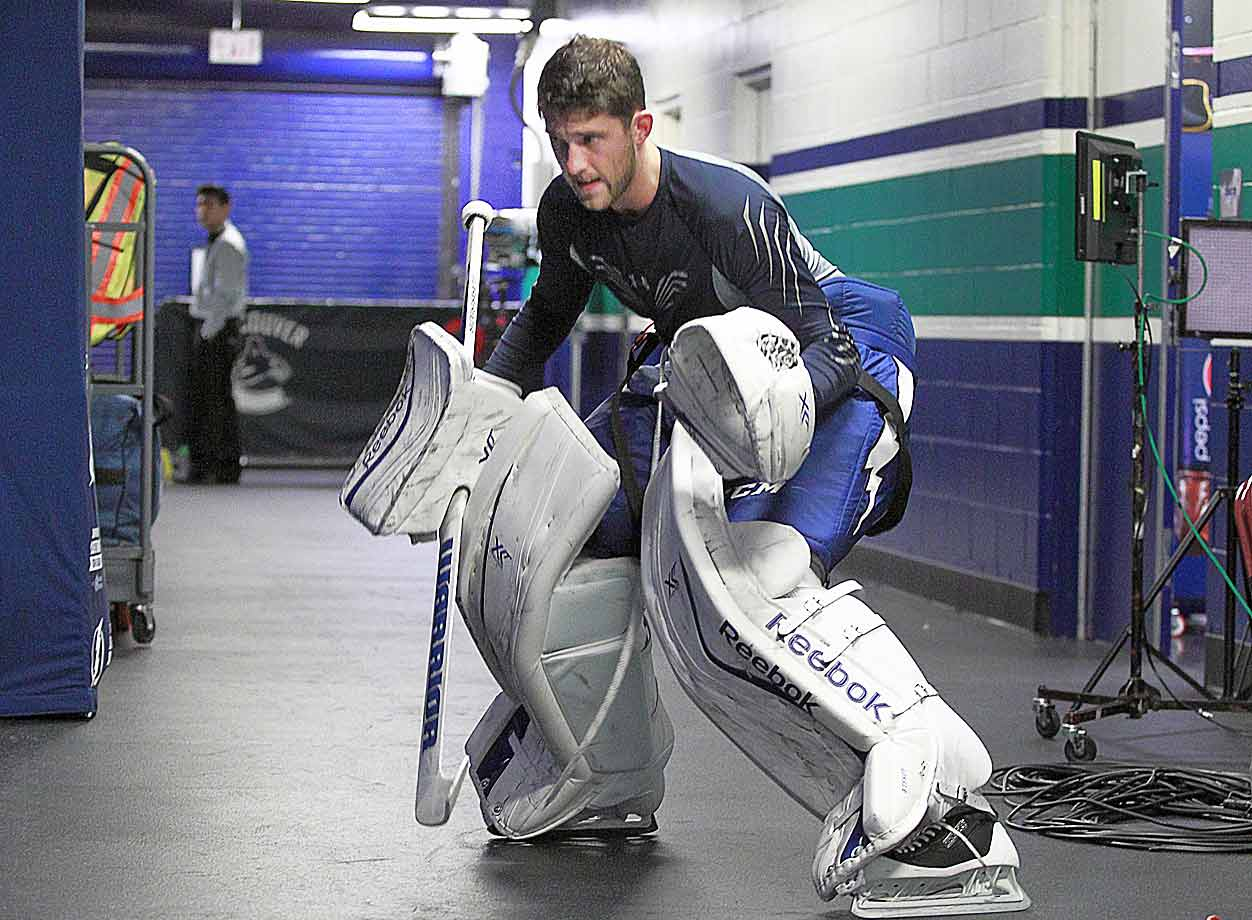 The Lightning's towering goalie warmed up outside Tampa Bay's dressing room before a game against the Canucks at Rogers Arena in Vancouver on Oct. 18.