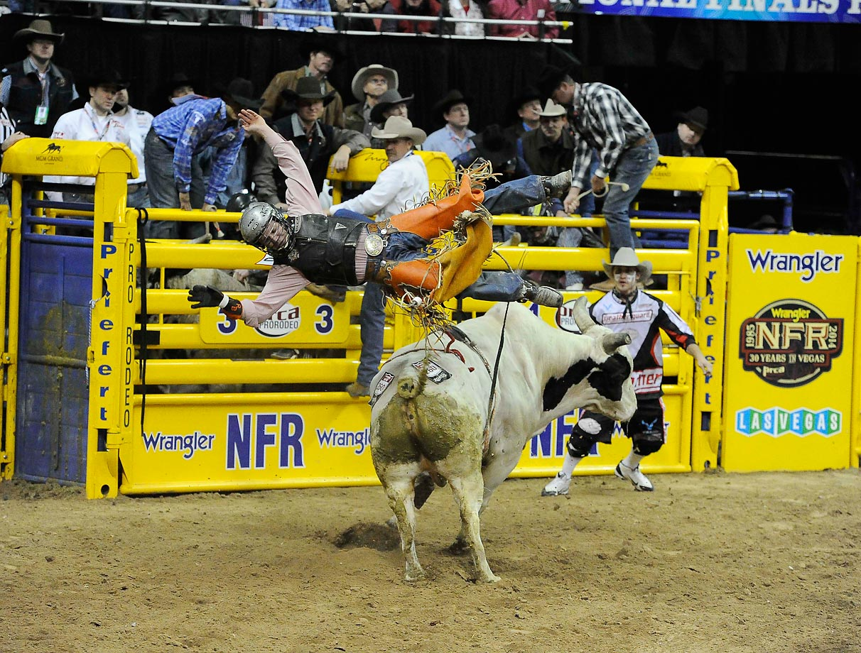 Reid Barker is bucked off his bull during the ninth go-round of the National Finals Rodeo in Las Vegas.