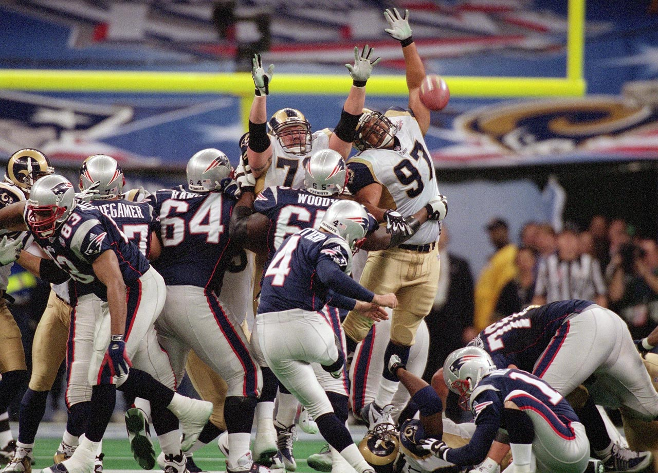 New England Patriots kicker Adam Vinatieri knocks through a game-winning field as the Pats stunned the St. Louis Rams, 20-17. Vinatieri's 48-yarder as time expired came after quarterback Tom Brady led the Patriots down the field with 1:30 left and no timeouts.