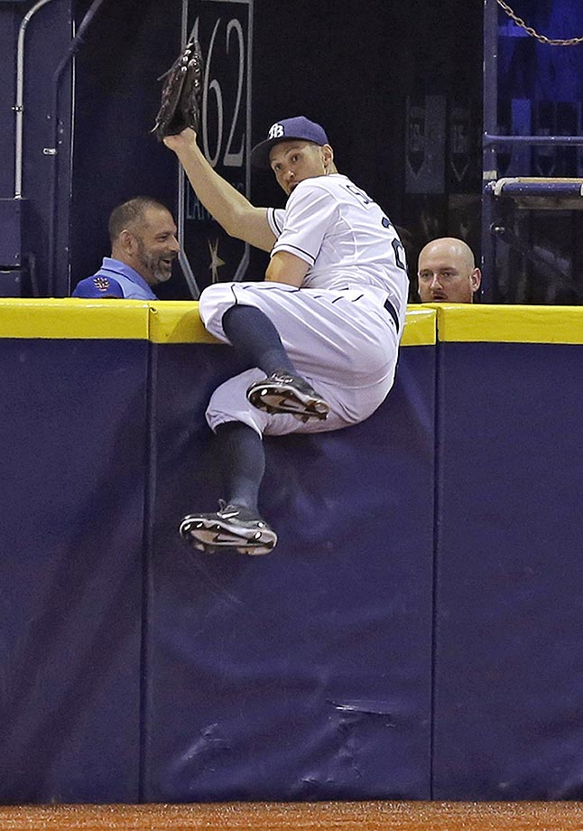 Tampa Bay Rays left fielder Grady Sizemore makes a diving catch to rob Wilmer Flores of a home run during an interleague game against the New York Mets.