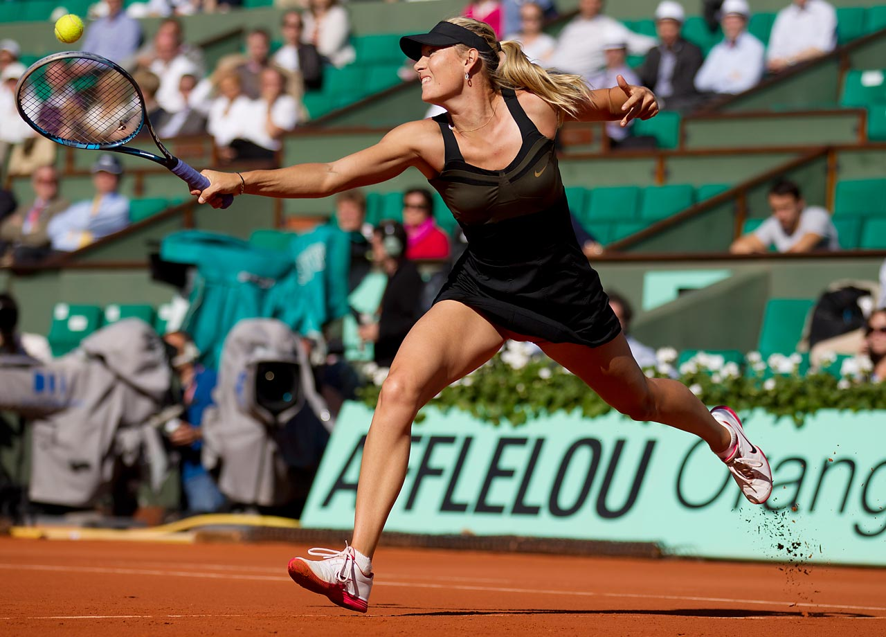 Maria Sharapova goes full-extension for this backhand lob during the semifinals of the 2012 French Open at Roland Garros. She went on to claim her first French Open title, which was the last of the four major championships for her.