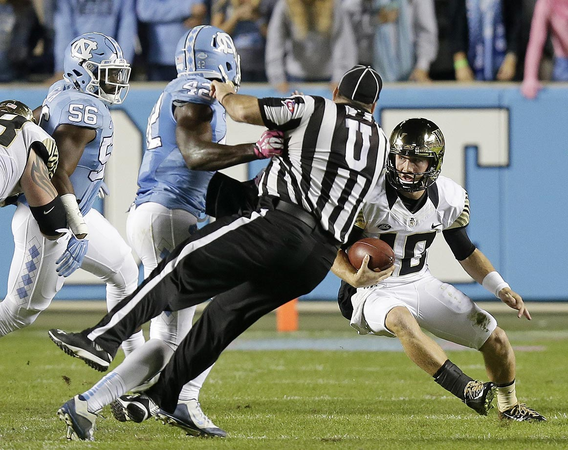 Shakeel Rashad of North Carolina collides with an official during a game against Wake Forest.
