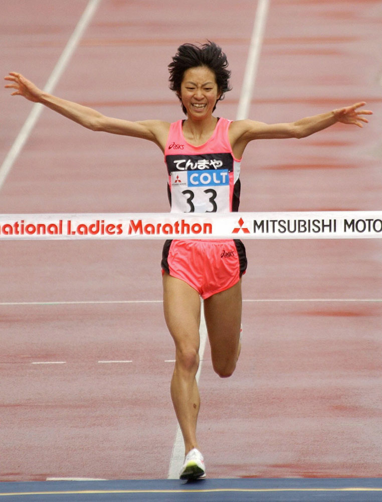 Japanese Naoko Sakamoto crosses the finish line in the Osaka International Women's Marathon at Nagai Stadium in Osaka.