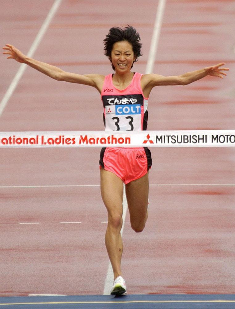 Japanese Naoko Sakamoto crosses the finish line in the Osaka International Women's Marathon at Nagai Stadium in Osaka.