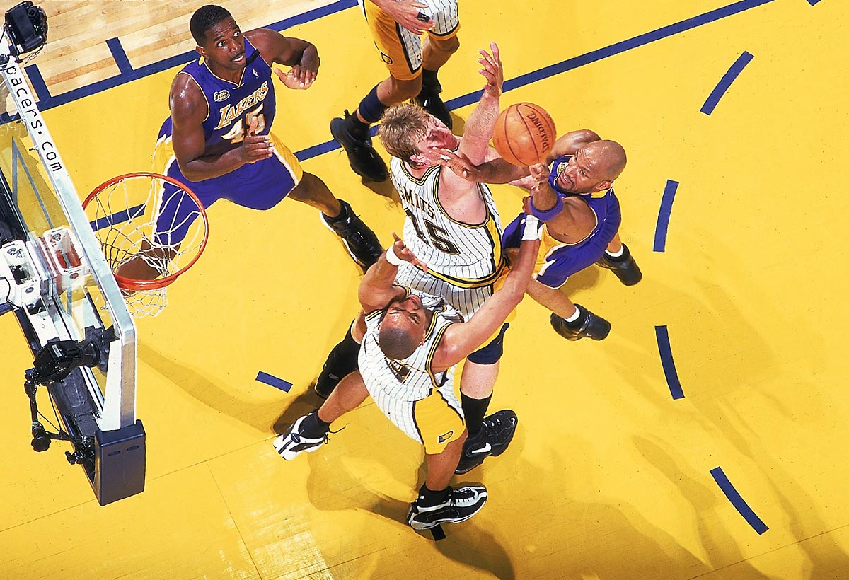 Ron Harper of the Lakers shoots over Pacers center Rik Smits in Game 4.