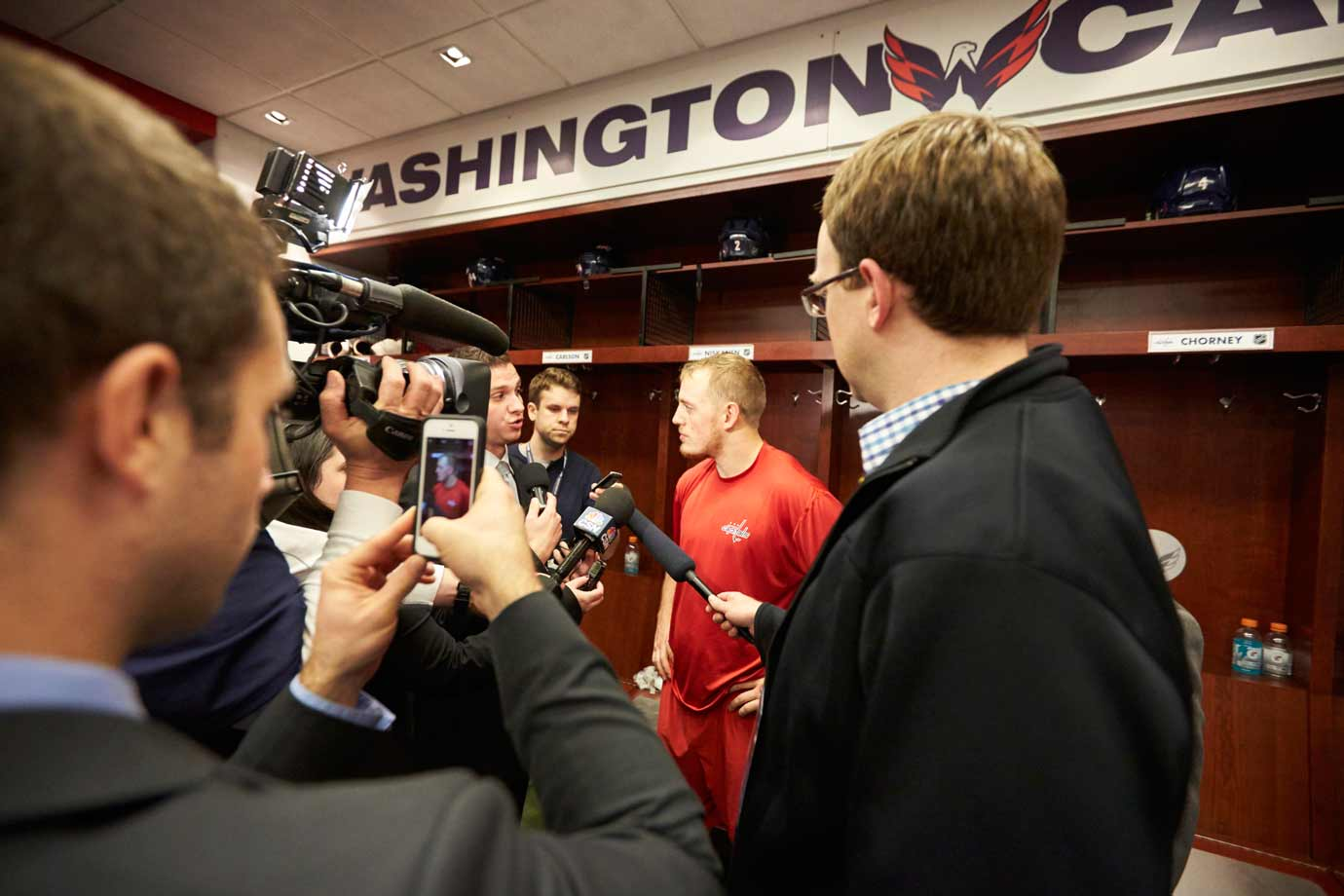 Defenseman Nate Schmidt conducts one of the hasty postgame interviews with the media. The Capitals have a 9:42 flight to catch at Dulles International and little time to spare.