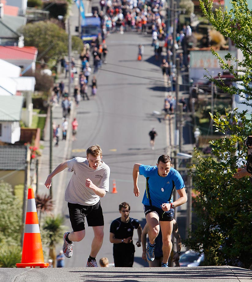 Glen Ballam (right) and Nick Abraham race up a 19-degree slope on Baldwin street in Dunedin, New Zealand.