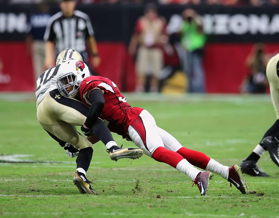 Cornerback Tyrann Mathieu of the Arizona Cardinals makes a big tackle on New Orleans Saints wide receiver Brandin Cooks.