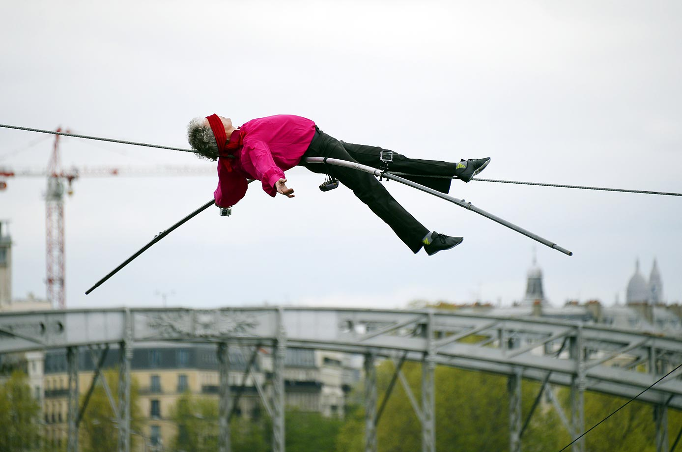 French tightrope walker Denis Josselin performs over the Seine river in Paris, on April 6, 2014.