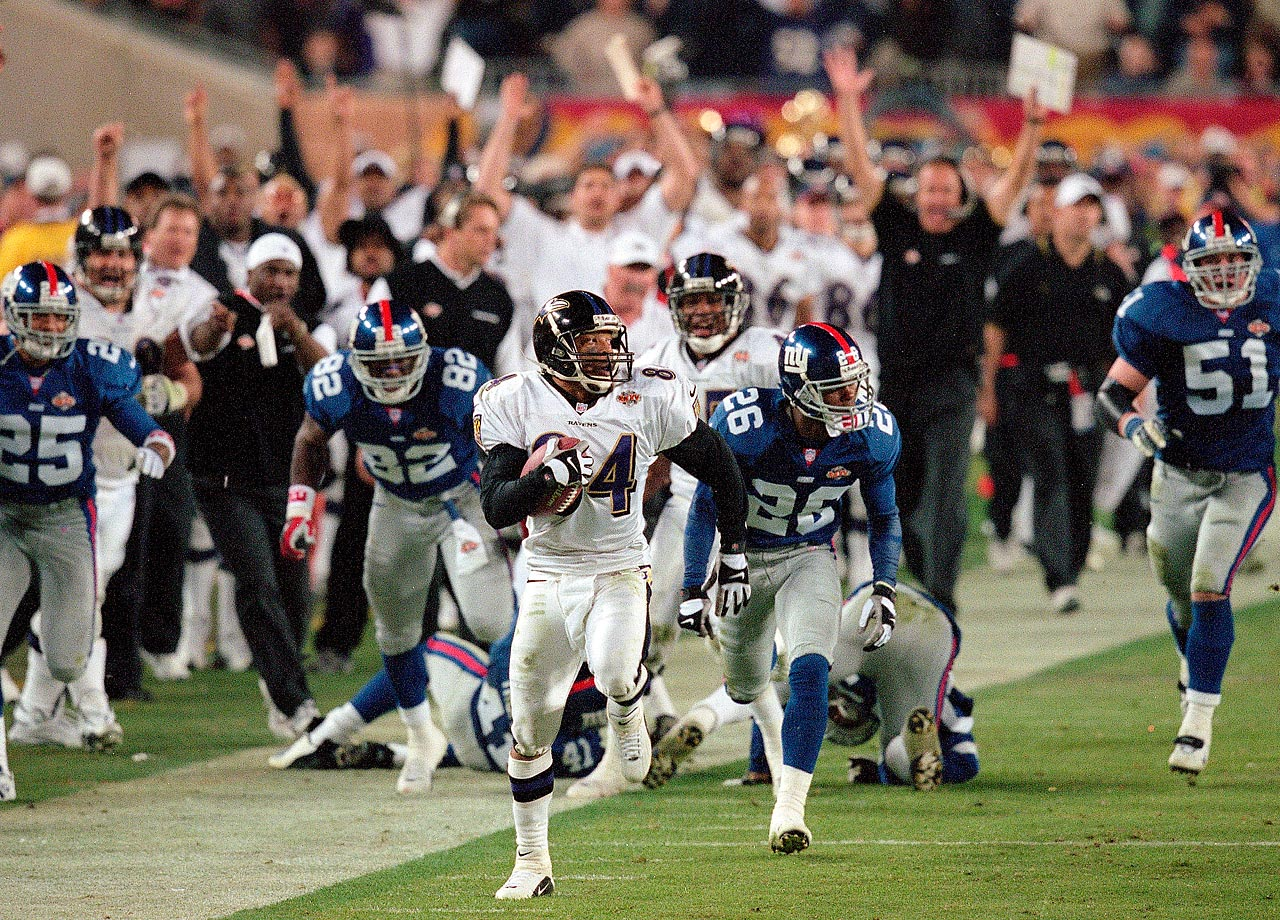 Jermaine Lewis sprints down the right sideline for an 84-yard kickoff return for a touchdown in the third quarter. The Baltimore Ravens wide receiver's return capped off a dizzying spell of touchdowns in which the Ravens returned an interception and a kickoff for a touchdown and the New York Giants returned a kickoff for a touchdown on three consecutive plays. Baltimore won 34-7.