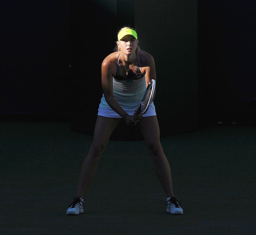 Sharapova waits for serve during a match against Carla Suarez Navarro during the BNP Paribas Open.