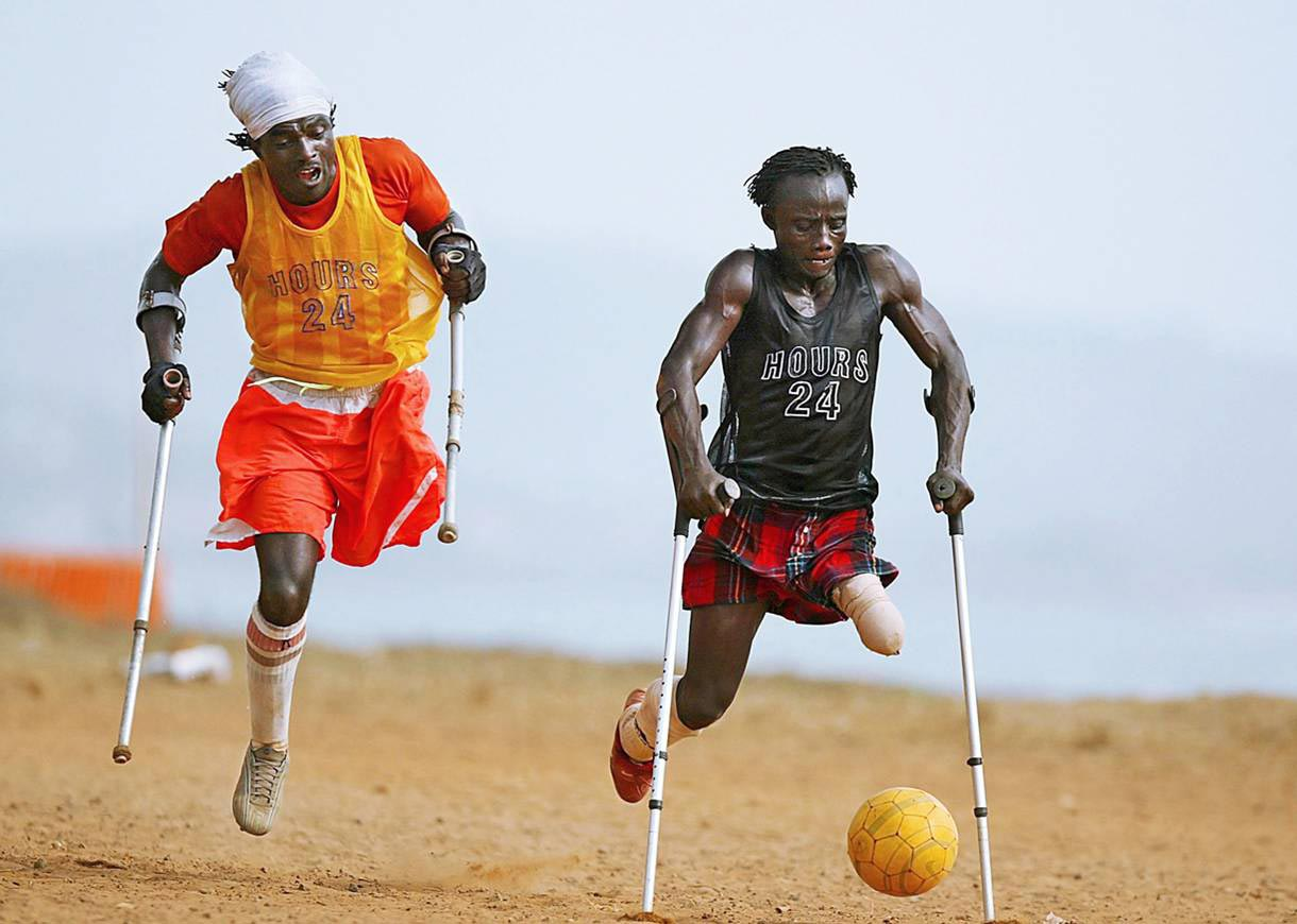 Sierra Leone, April 6, 2006 | The members of the Single Leg Amputee Sports Club of Sierra Leone chase for the ball in Freetown. A brutal civil war left more than 6,000 amputees in Sierra Leone.