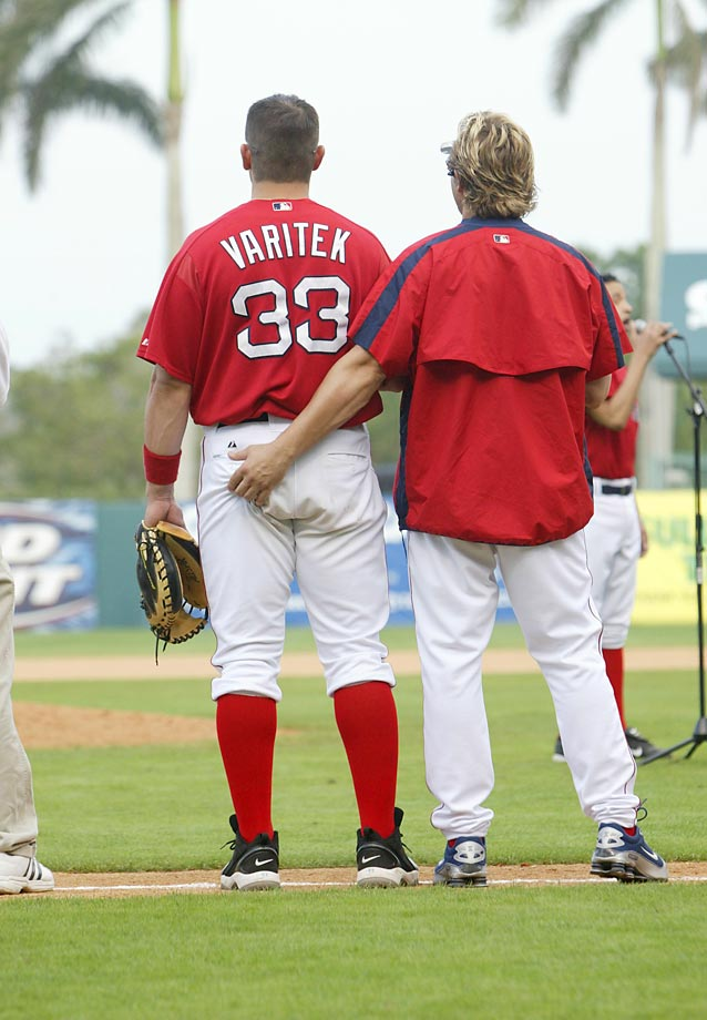 Having heard he was a switch hitter, Kevin Millar takes a chance on a squeeze play with teammate Jason Varitek. Both men were integral parts of the 2004 Red Sox World Series team.