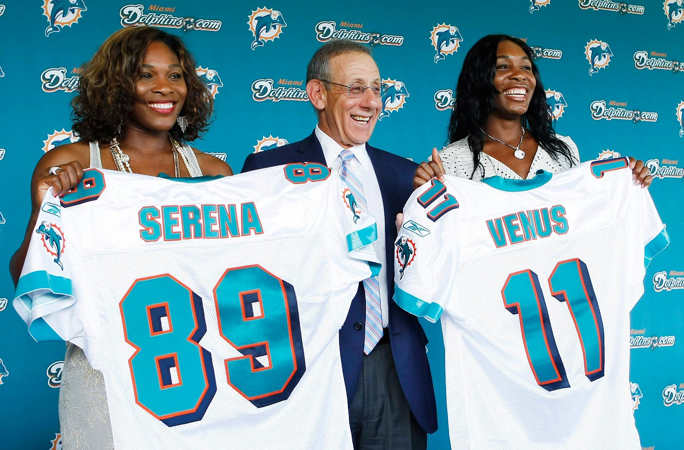 Miami Dolphins owner Stephen Ross with Serena and Venus after it was announced they had become minority owners of the NFL football team.