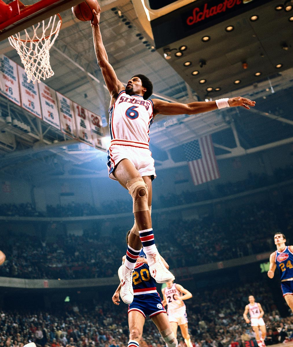 January 1977 | Philadelphia 76ers forward Julius Erving gets full extension on a one-handed dunk against the Denver Nuggets.