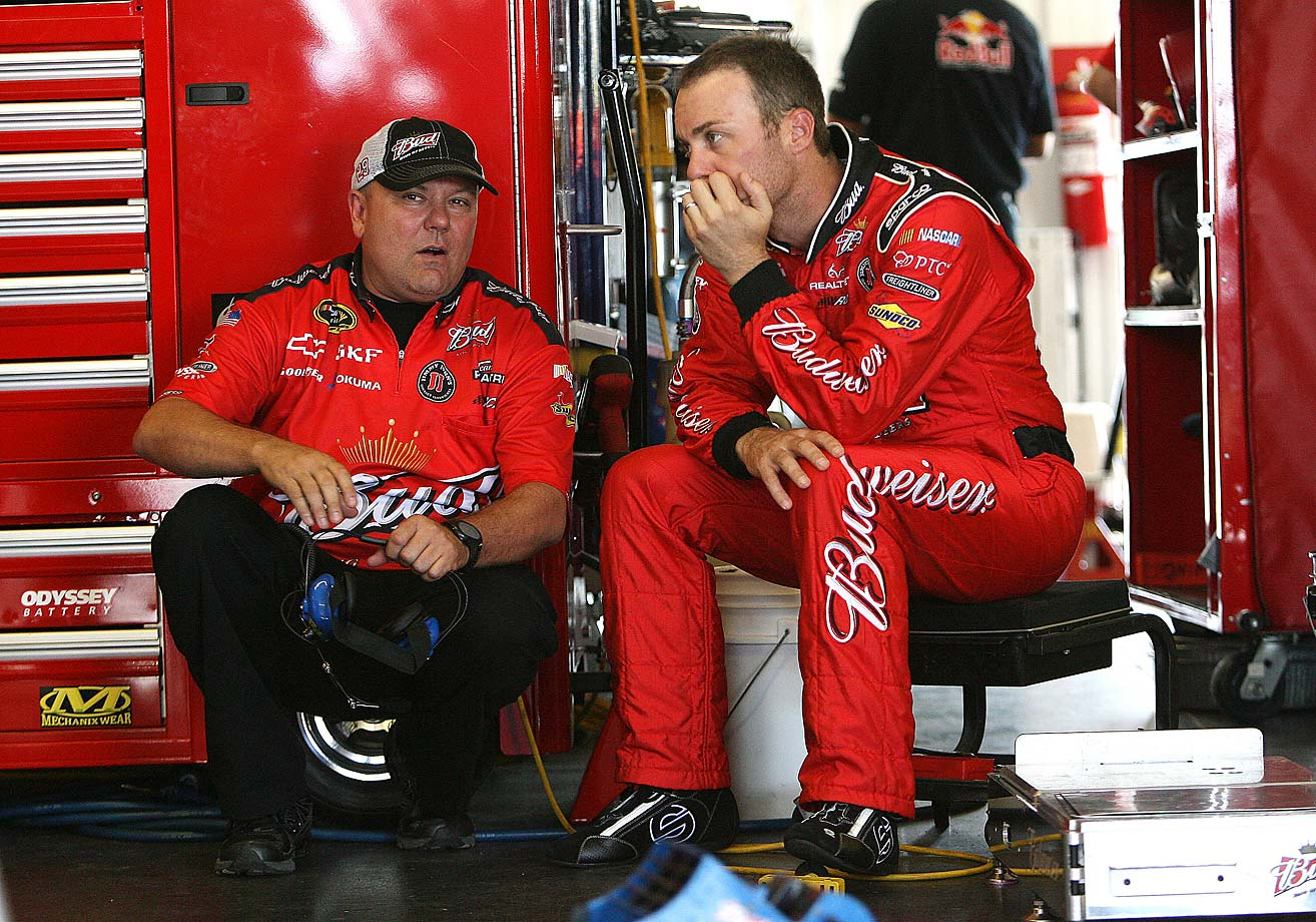 Kevin Harvick chats with crew chief Gil Martin during practice at Pocono Raceway in Long Pond, Pa., in June 2011.