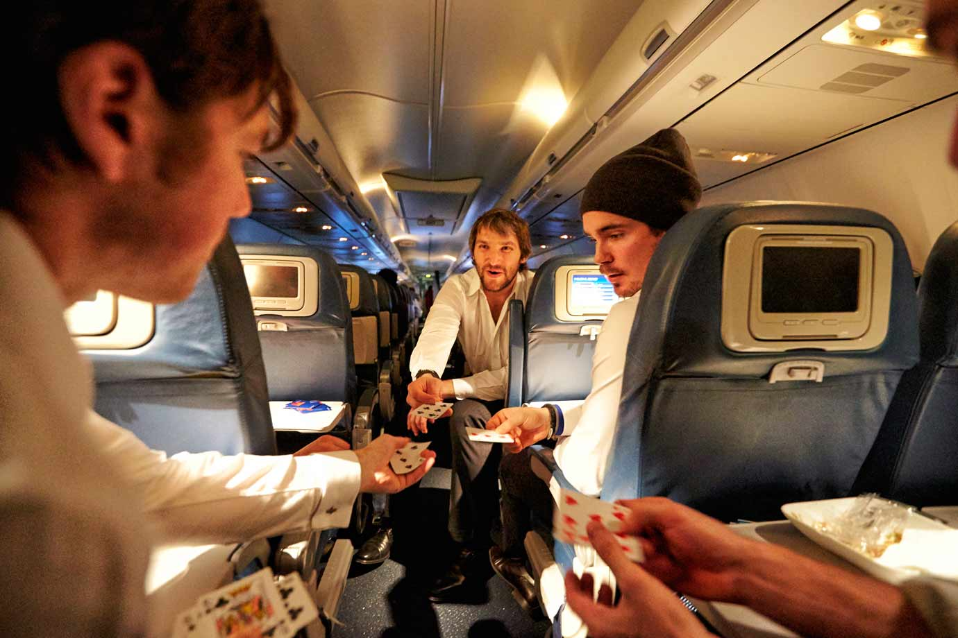 On their way to Toronto aboard a 737, Alex Ovechkin and teammates eat and relax with a game of 7 Up, 7 Down.
