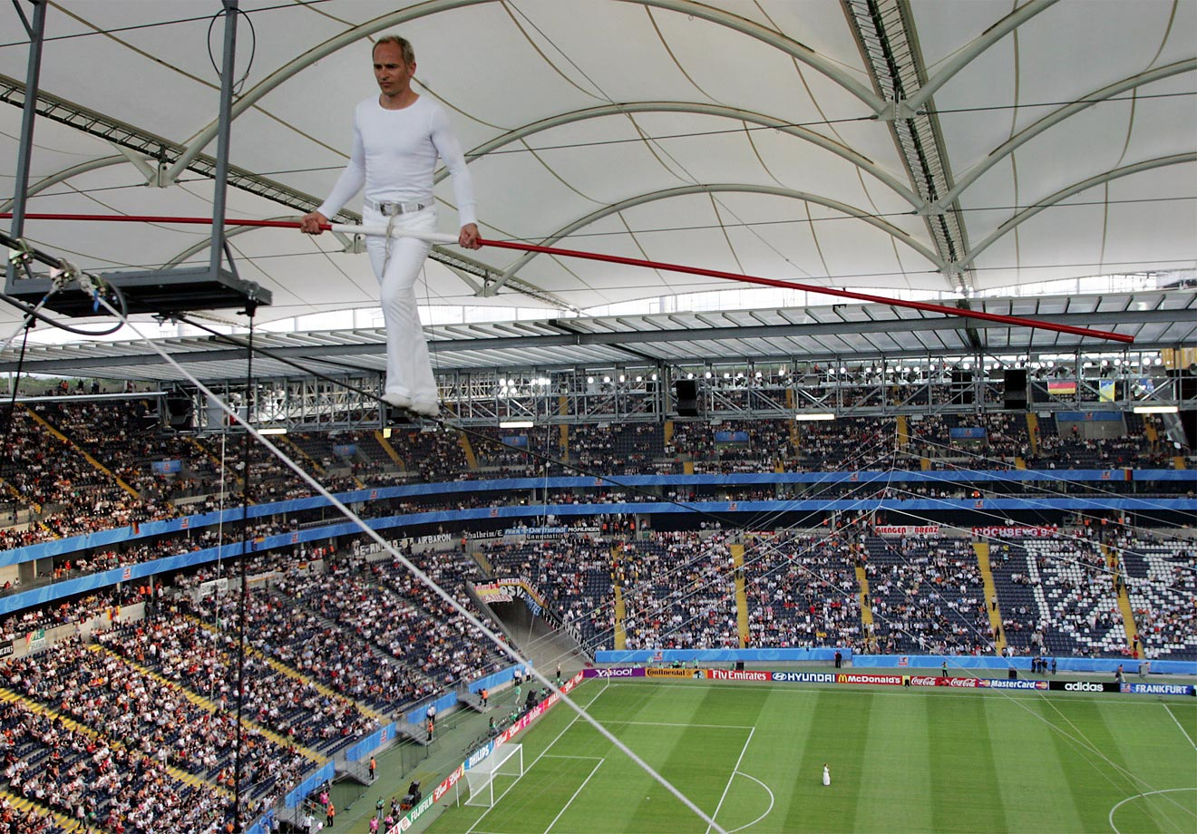 Artist David Dimitri from Switzerland performs on the high wire during the opening ceremony prior to the Confederations Cup match between Germany and Australia at the FIFA World Cup stadium in Frankfurt, Germany.