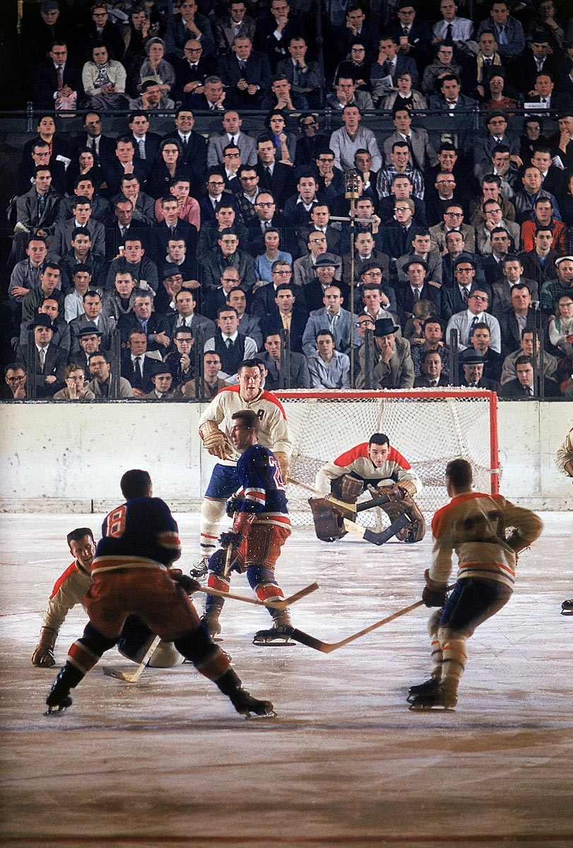 Canadiens at Rangers, Dec. 18, 1957 | Montreal Canadiens goalie Jacques Plante surveys the ice without a mask during a game between the Canadiens and the New York Rangers at Madison Square Garden. Plante was the first NHL goalie to wear a goaltender mask on an everyday basis, a practice he started during the 1959-60 season.