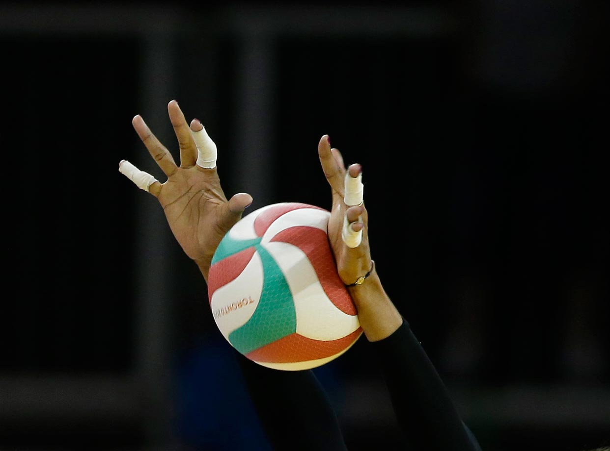 Rachael Adams blocks a spike over the net during the U.S. team's volleyball semifinal against the Dominican Republic at the Pan Am Games in Toronto.