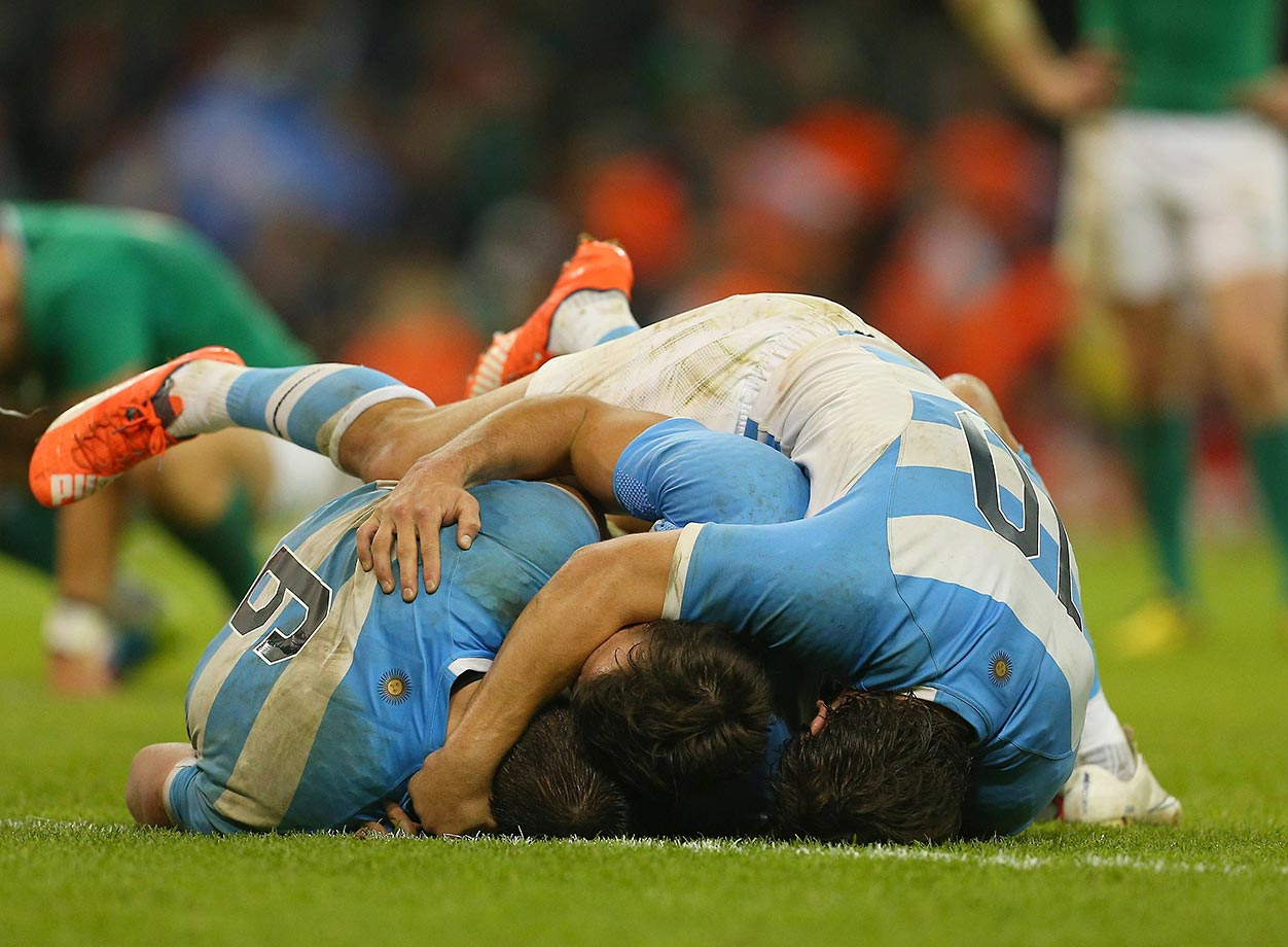 Pablo Matera, Juan Imhoff and Nicolas Sanchez of Argentina celebrate at an IRB Rugby World Cup quarterfinal match.