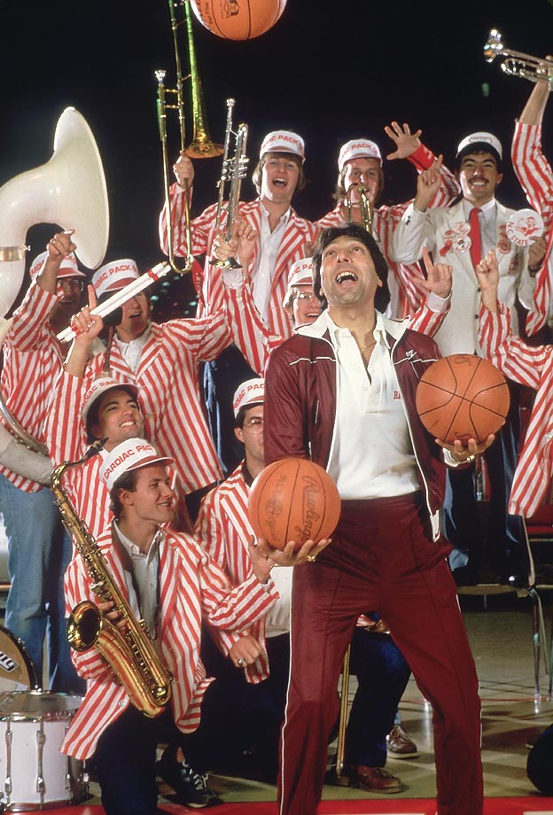 Jim Valvano was the toast of the town after leading NC State to the 1983 NCAA championship. In this photo, he celebrates with the Wolfpack band.