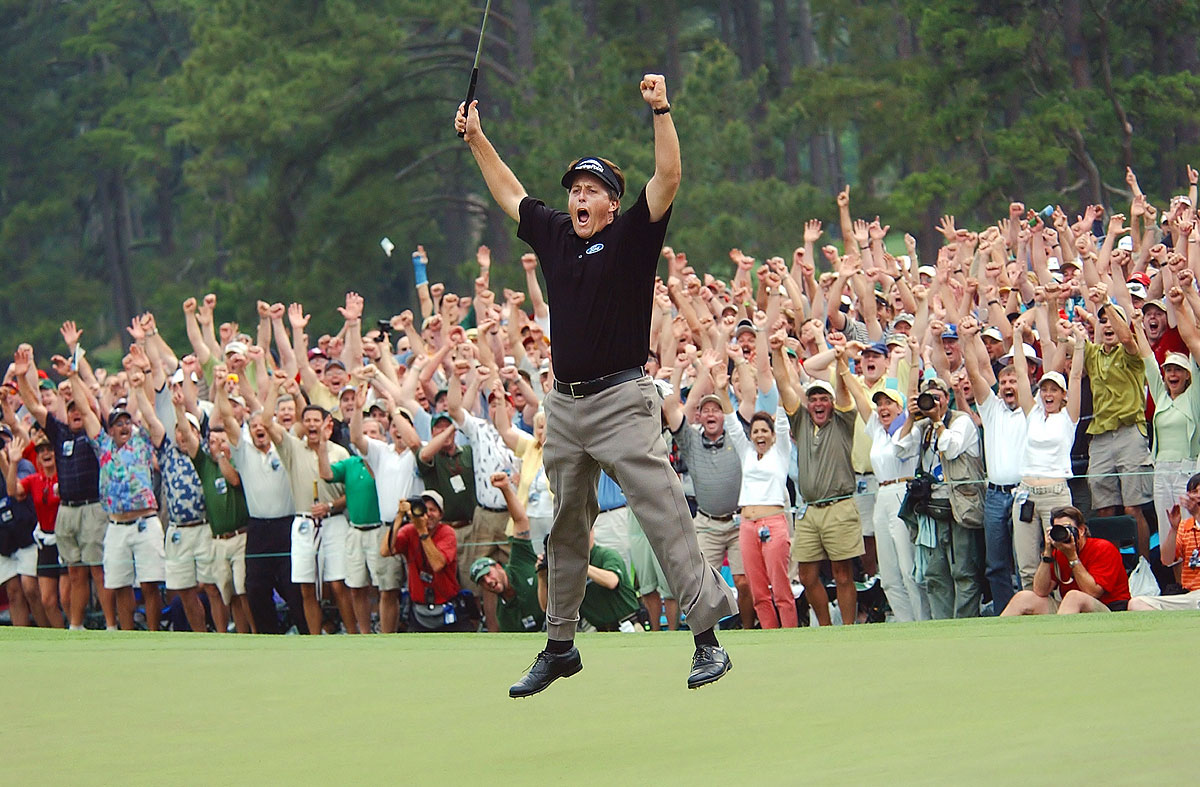 Masters, April 11, 2004 | Phil Mickelson celebrates after making an 18-foot putt on the 18th hole to clinch a one-stroke victory at the Masters. After years of being called the best player without a major victory, Lefty broke through with his nine-under-par performance. He won the tournament again in 2006 and 2010.