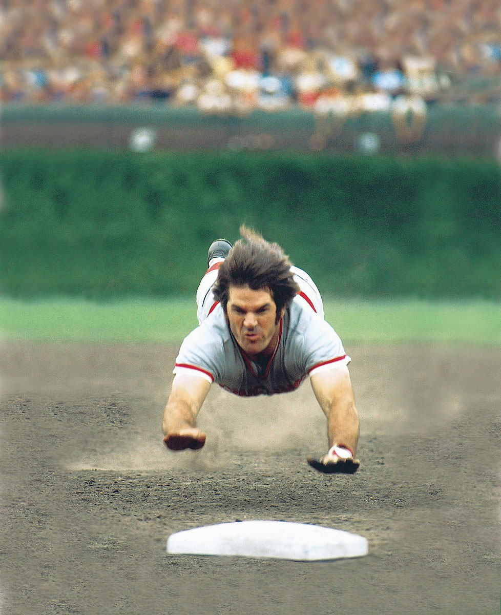 Reds vs. Cubs, August 1975 | Cincinnati's Pete Rose dives into third base in a game with the Cubs at Wrigley Field. Baseball's all-time hits leader, Rose was 4-for-9 and drew eight walks during the series with Chicago.
