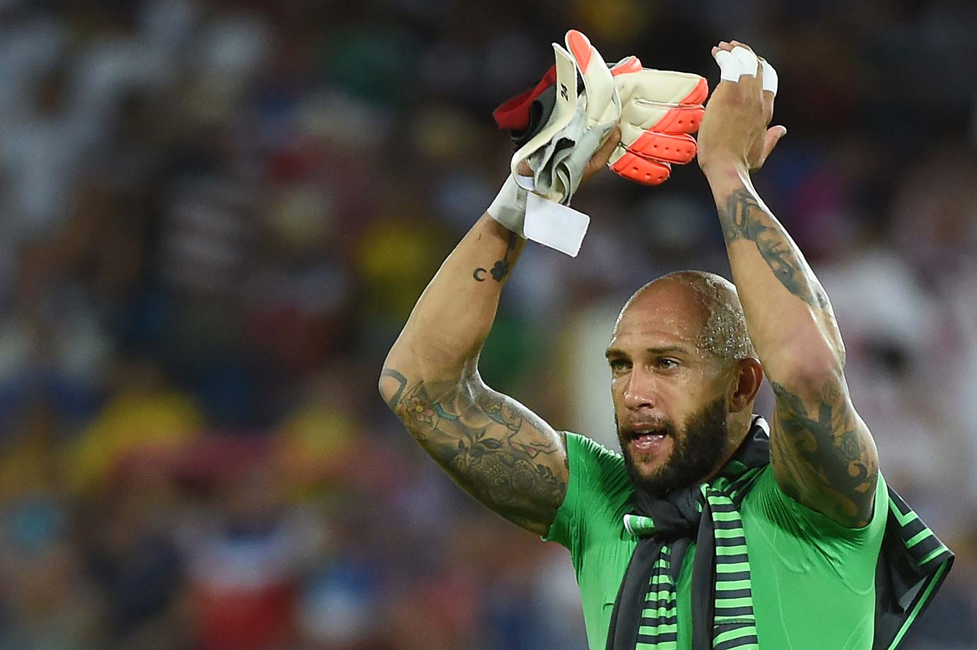 Tim Howard celebrates the hard-earned victory.