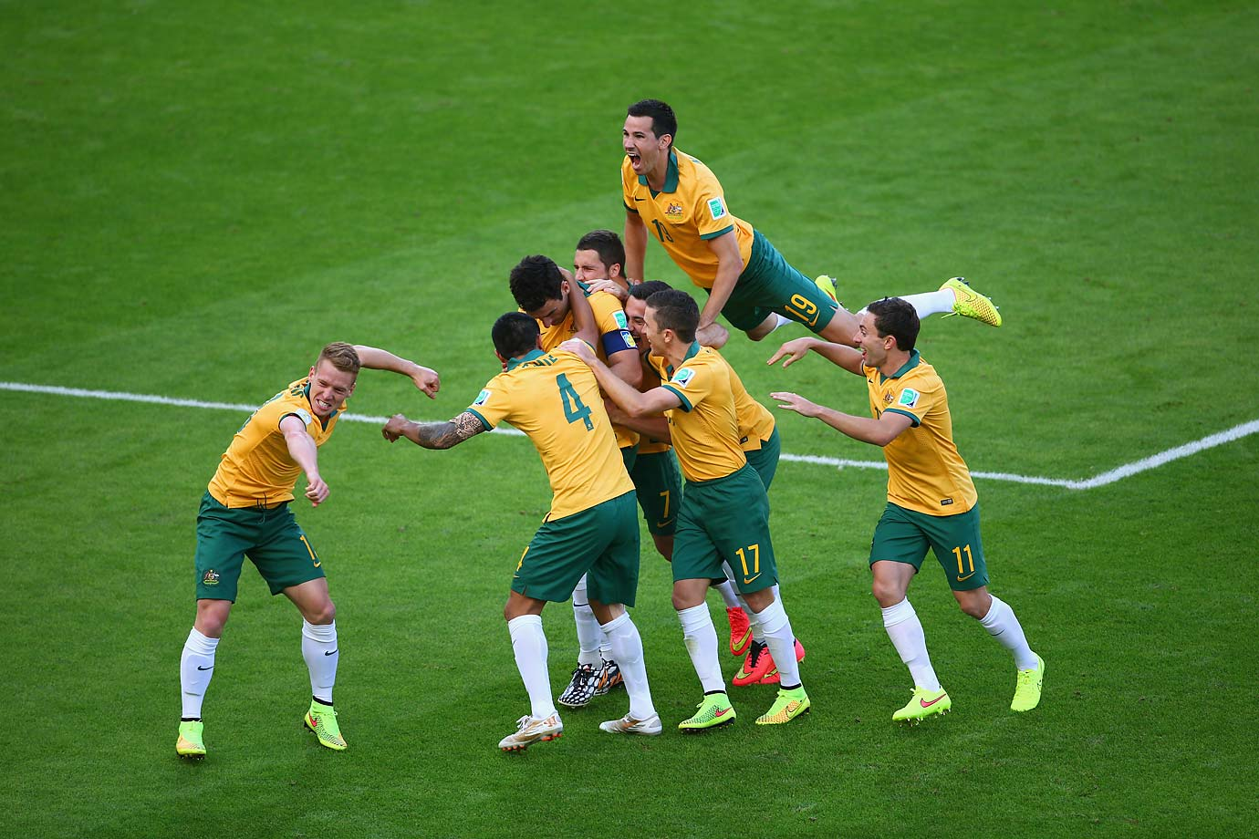 Mile Jedinak of Australia celebrates with his teammates after scoring Australia's second goal of the Group B match against the Netherlands.