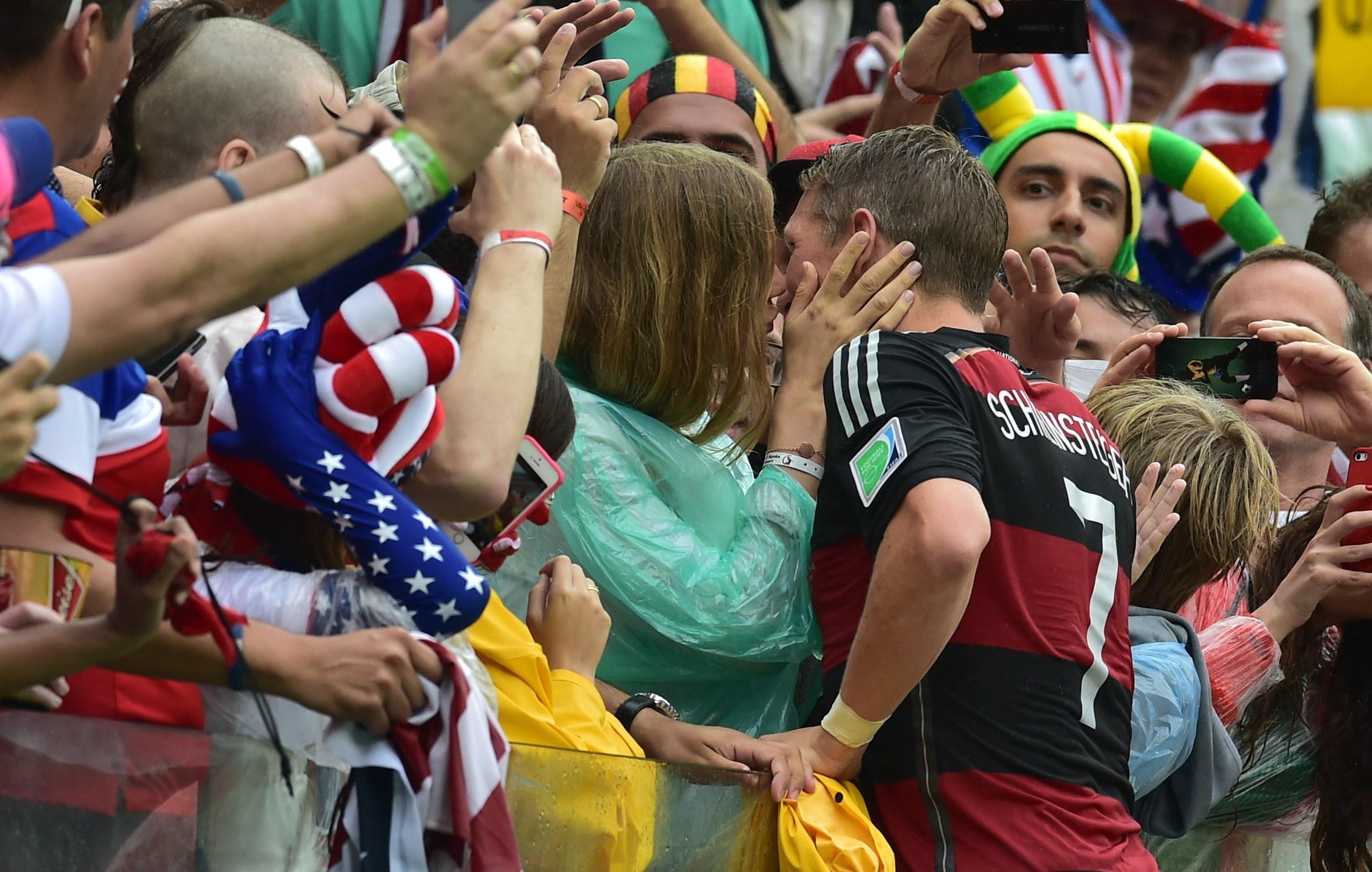Sarah Brandner kisses boyfriend Bastian Schweinsteiger after Germany's World Cup Group Stage win over USA, 6/26/2014