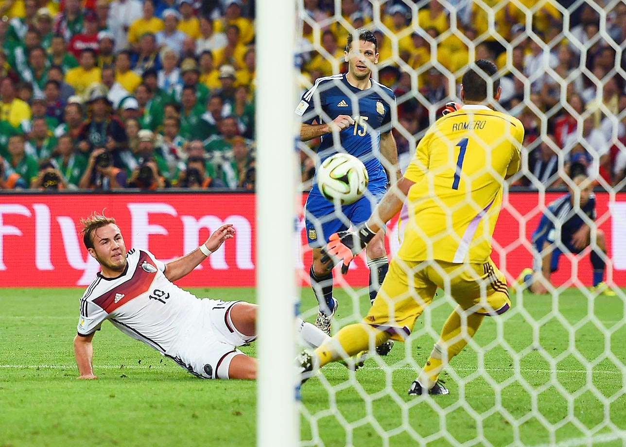 Argentine goalkeeper Sergio Aguero dives the wrong way as Germany's Mario Götze scores the lone goal in the World Cup Final during the second half of extra time at the Maracanã in Rio de Janeiro, Brazil.
