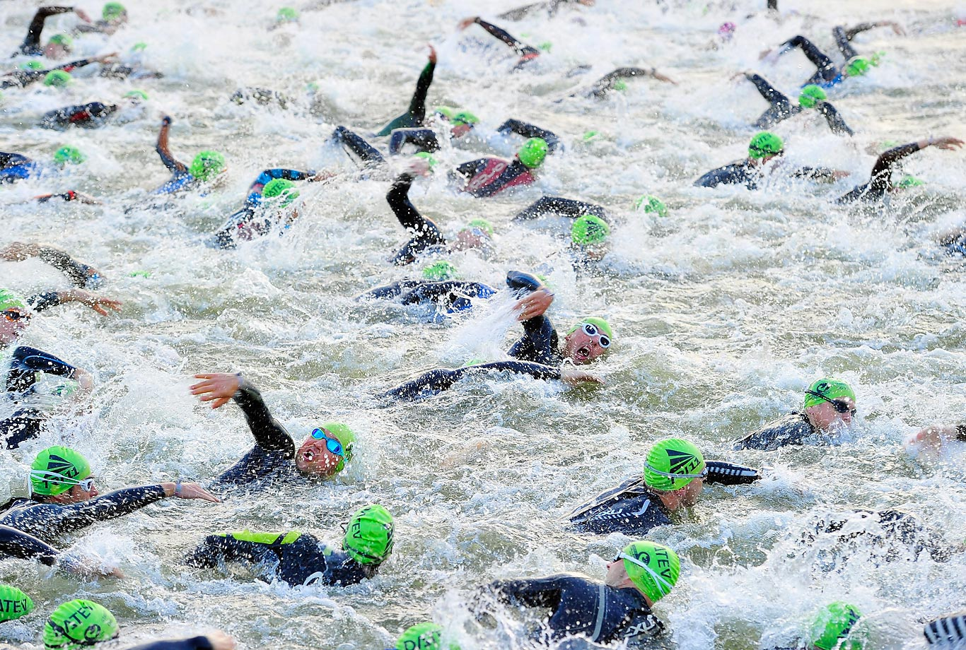 Participants competing in the swim leg of Challenge Roth swim through the Rhine-Main-Danube Canal just outside of Roth, Germany.