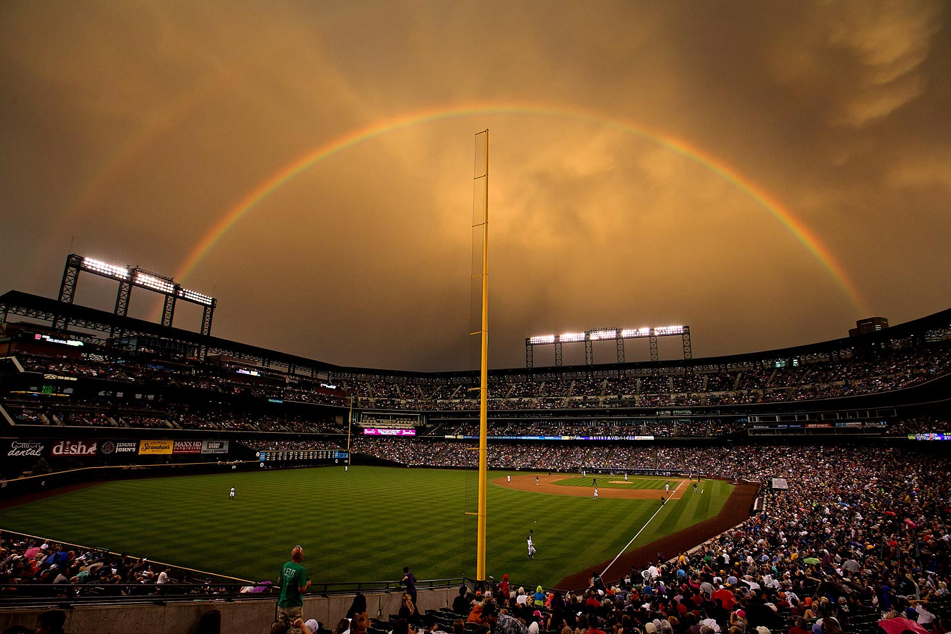 This incredible double rainbow could be seen over Coors Field on July 25, 2014.  Surprisingly, left fielder Corey Dickerson of the Rockies was able to concentrate enough to make a catch off a fly ball hit by Gaby Sanchez of the Pirates.