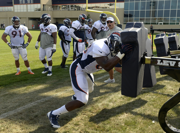 Kenny Anunike (68) runs through drills on during training camp in July.