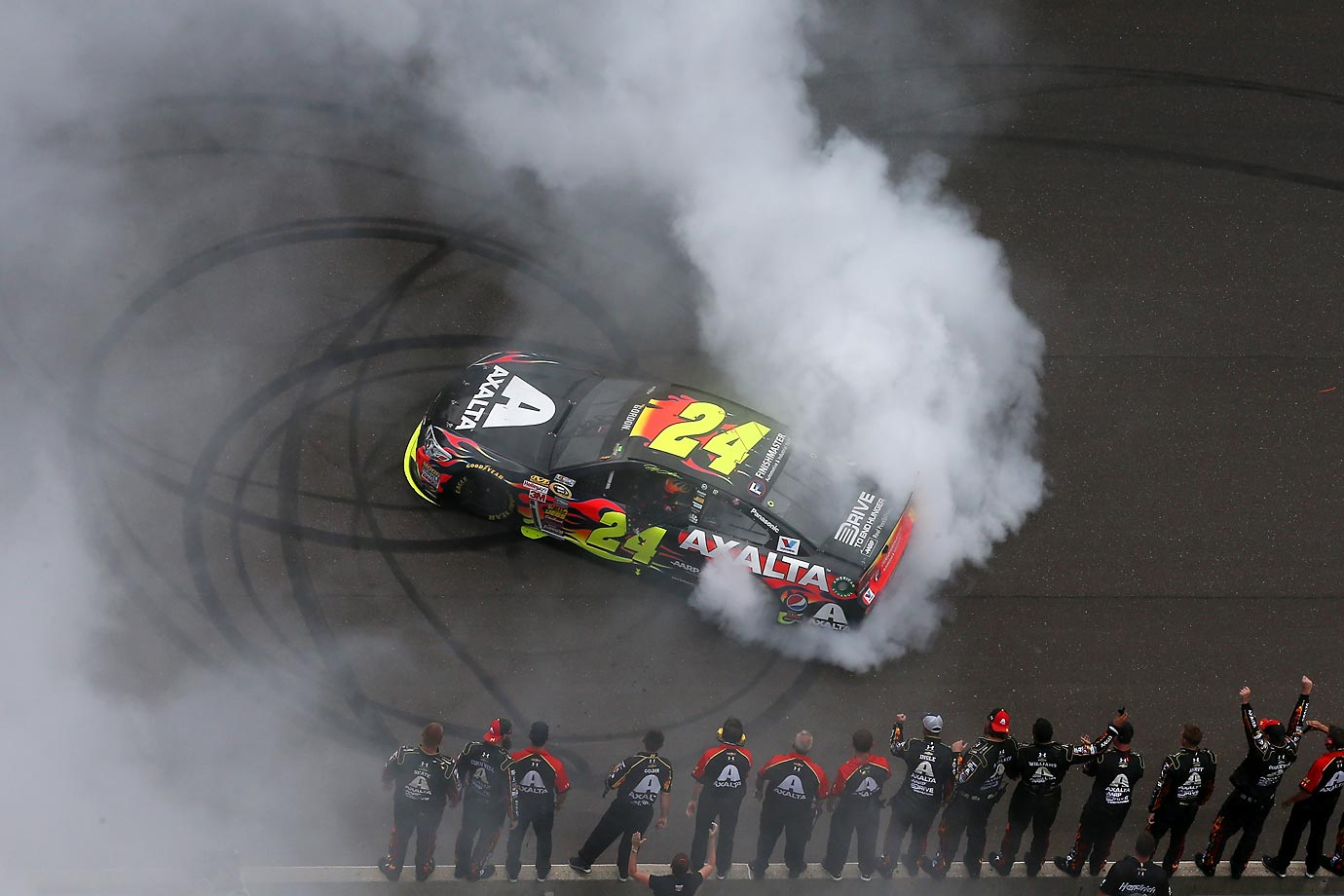 Jeff Gordon celebrates his fifth victory at the Brickyard 400 in his home state of Indiana with a burn out. The win came just eight days before Gordon's 43rd birthday.