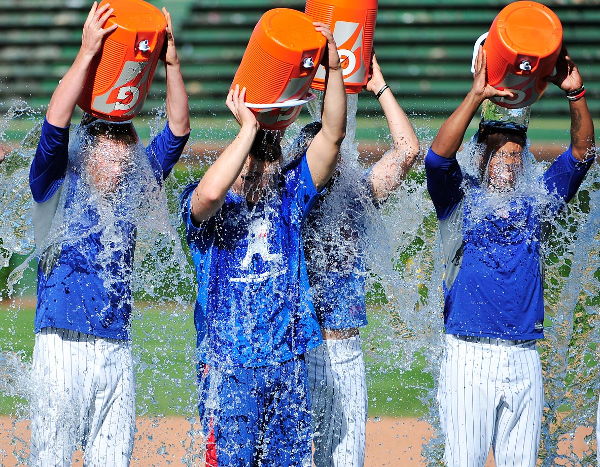 The Chicago Cubs pour ice water on themselves to raise money for ALS after their game against the Brewers.