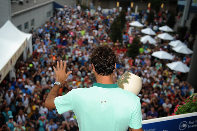 Federer poses with the winner's trophy on Champion's Balcony after his final match against David Ferrer in the Western & Southern Open.