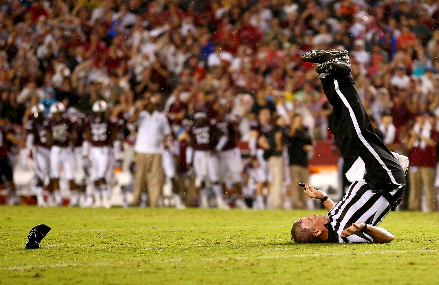 Umpire Russ Pulley flips over during the Georgia-South Carolina game.