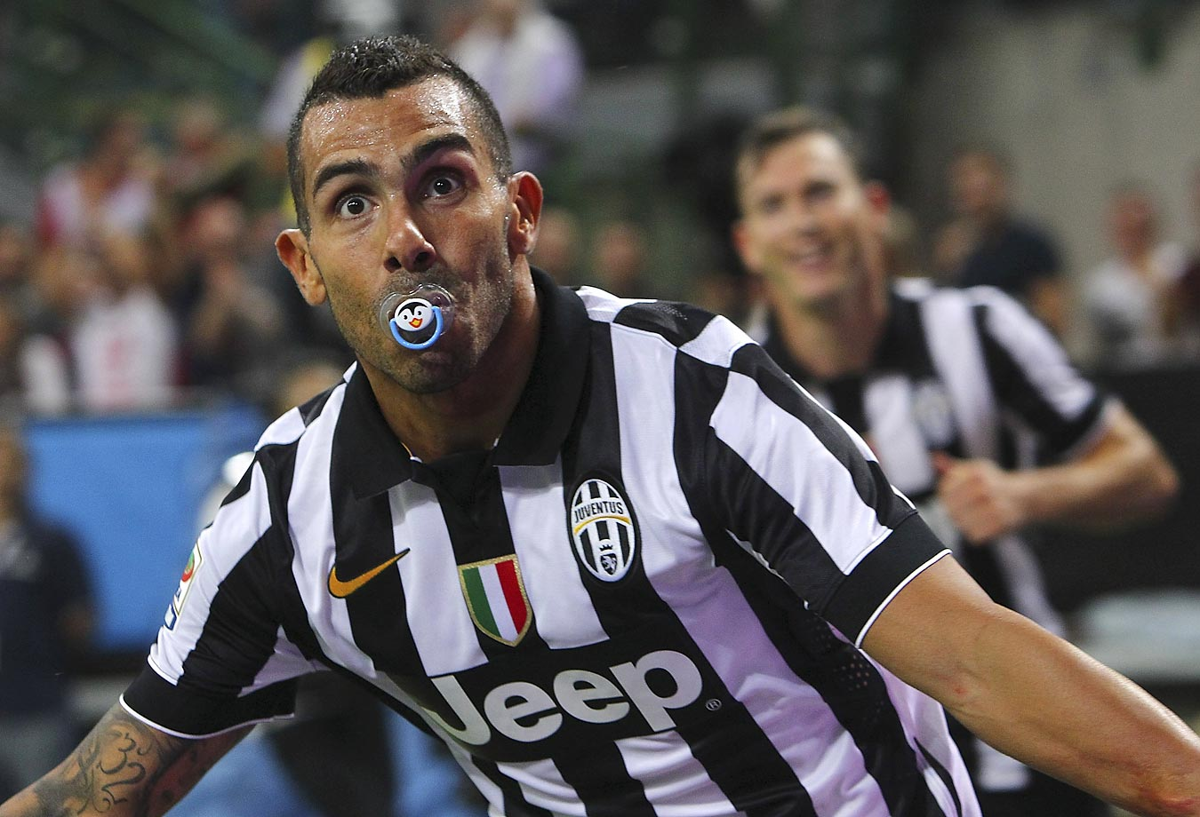 Carlos Tevez of Juventus FC celebrates after scoring the opening goal.