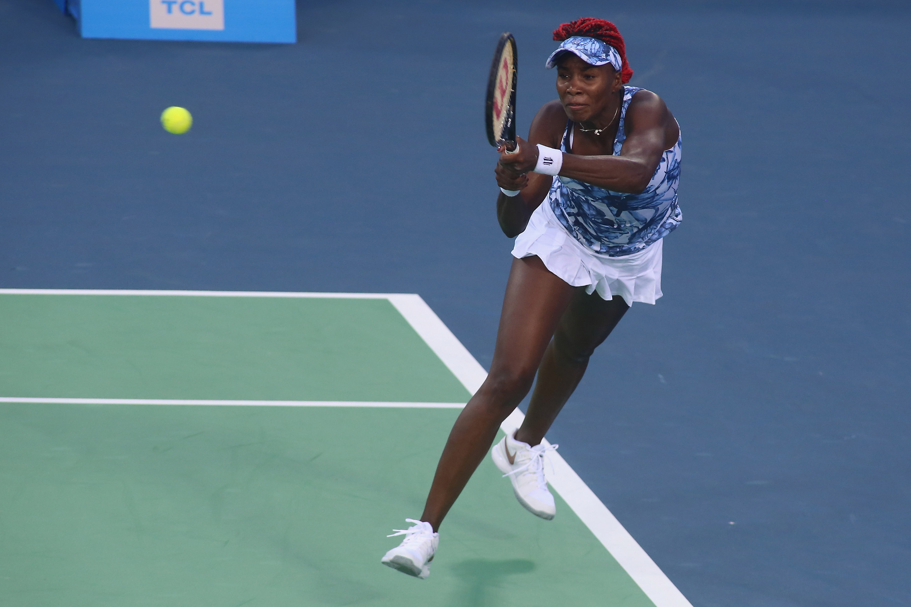 Venus Williams returns a shot during her match against Caroline Garcia of France.