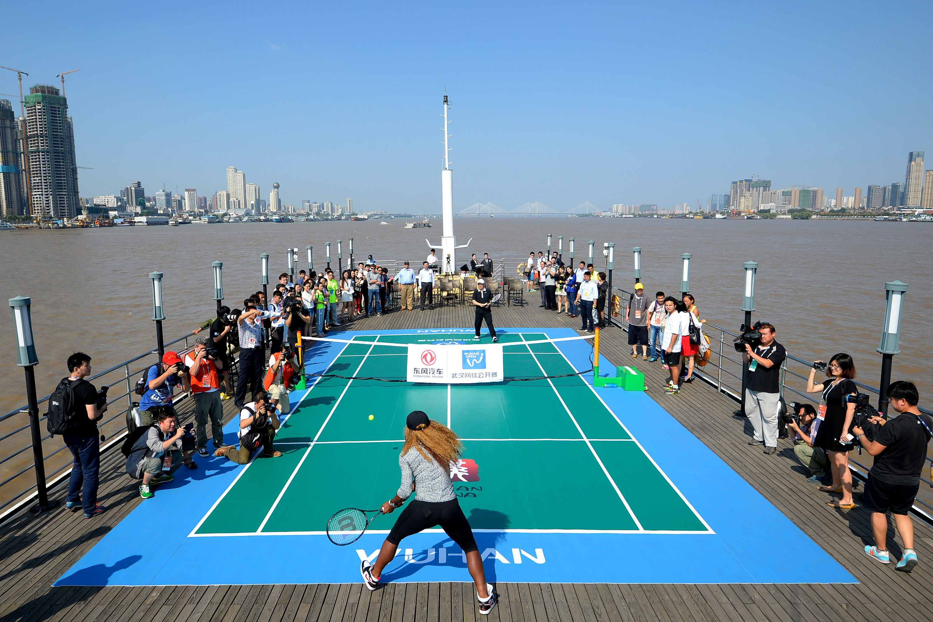 Serena Williams attends a tennis activity at Yangtze River during the second day of the Wuhan Open.