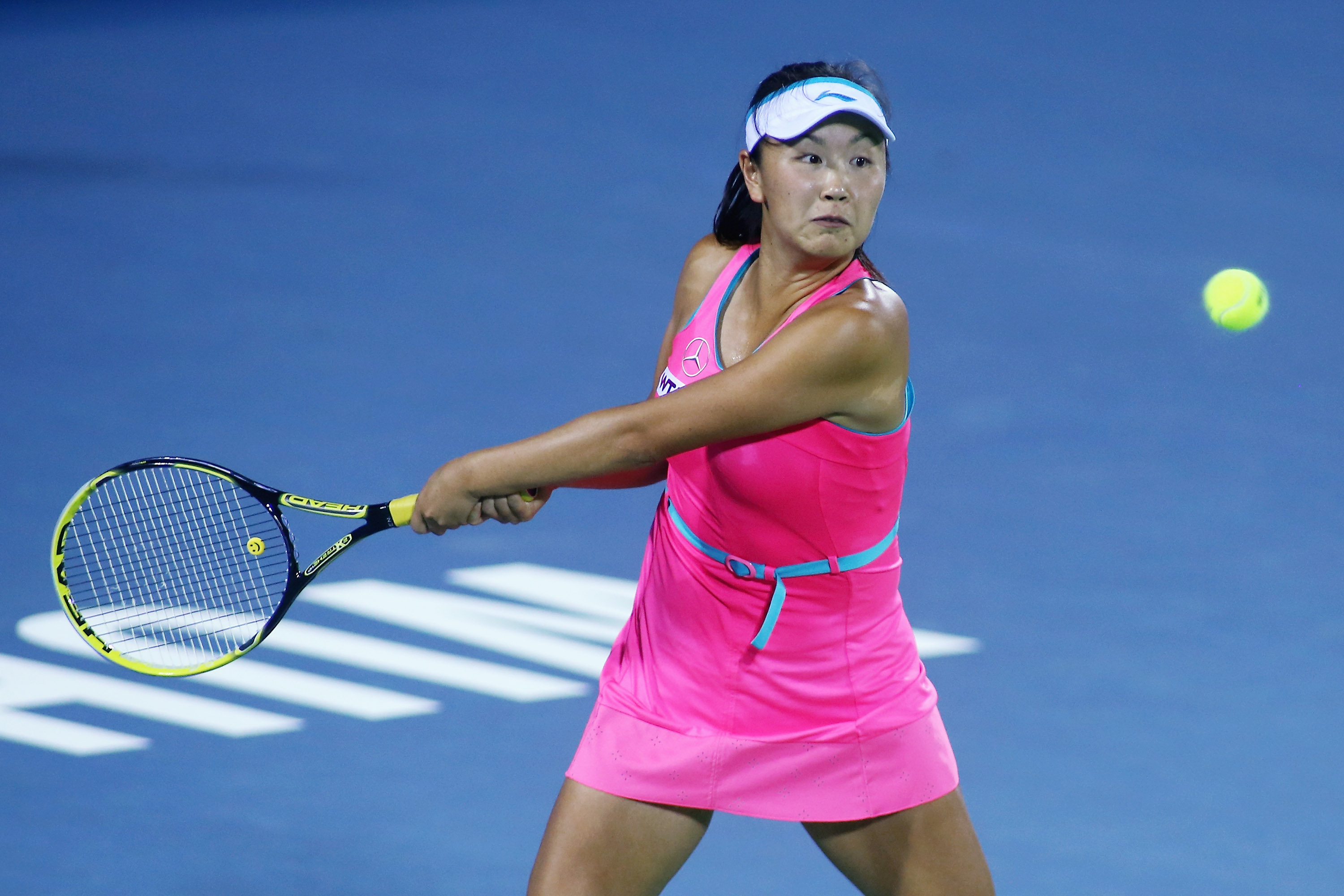 Shuai Peng of China returns a shot during her match against Mona Barthel.