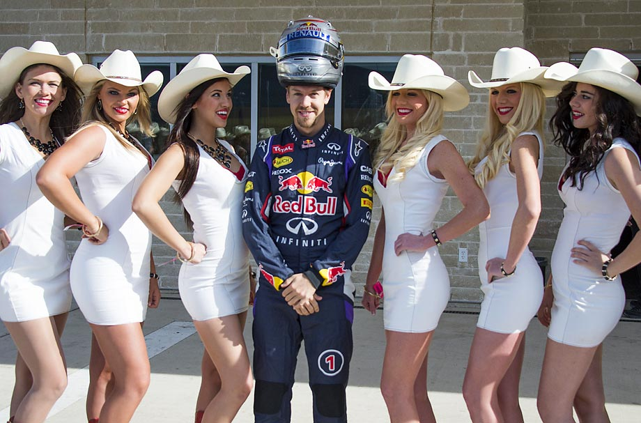 Sebastian Vettel poses with the COTA Girls prior to the U.S. Formula One Grand Prix.